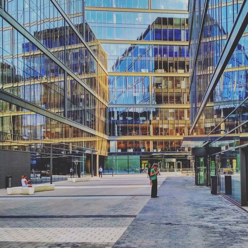 People Women Workers Staff Whitecollar Office Building Glass Glasshouse Bench Patio Square Reflex Reflection Mirror Sun Dusk Próximo Warsaw City Modern Men Full Length Architecture Building Exterior Built Structure Sky Office Building Financial District  Calm