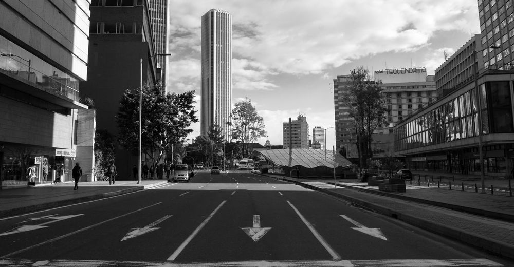 Up is down Check my instagram!! @ptafoto16 Architecture Bogotá Building Exterior Built Structure Car City Cloud - Sky Colombia Colombia ♥  Day Land Vehicle Mode Of Transport No People Outdoors Road Road Marking Sky Skyscraper Street The Way Forward Transportation Tree