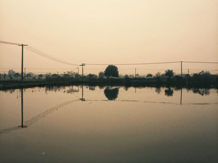 Lake Lake View Landscape Reflection Water Water Reflections Nature Clear Sky No People Outdoors Standing Water Scenics Beauty In Nature Electricity Pylon Quiet Moments