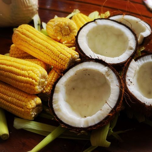 Close-Up Of Corn On Cobs With Coconuts