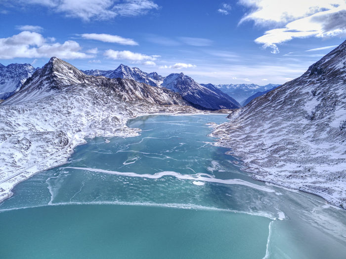 Drone  Aerial Photography Beauty In Nature Blue Cloud - Sky Cold Temperature Day Dronephotography Fozen Water Mountain Mountain Range Nature No People Outdoors Scenics Sea Sky Snowcapped Mountain Tranquil Scene Tranquility Water Waterfront Winter