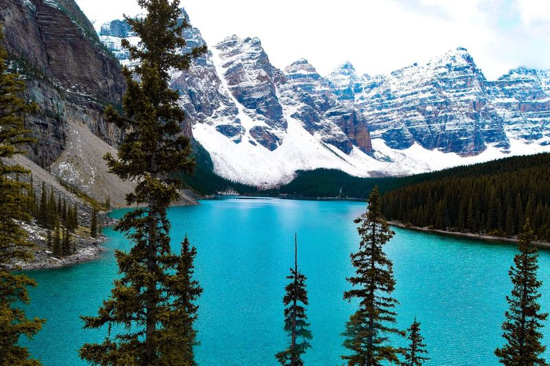 Scenic View Of Moraine Lake By Mountains Against Sky During Winter