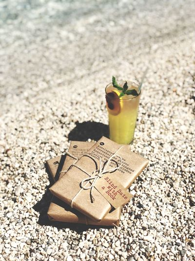 Blind Date with a Book Beachphotography Beach Book Hillsidebeachclub Sunlight Land Food And Drink Nature Beach Sand Drink Still Life