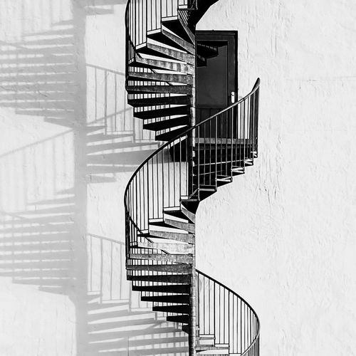 Spiral staircase against building