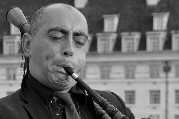 Close-up portrait of man smoking outdoors