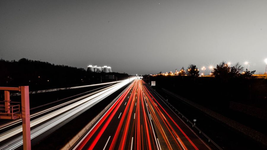 Motorway next to the allianz arena Illuminated Light Trail Motion Transportation Long Exposure Tail Light Tree Speed Highway Direction Red Road Night No People Mode Of Transportation Rail Transportation Nature Sky The Way Forward Plant