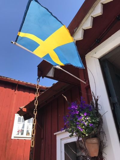 Summerheat in april 2018 Strängnäs Oldbuilding Cafe Time Swedish Fika Old Buildings The Week on EyeEm Building Exterior Architecture Built Structure Building Low Angle View Nature Decoration Flag Outdoors Day Sky