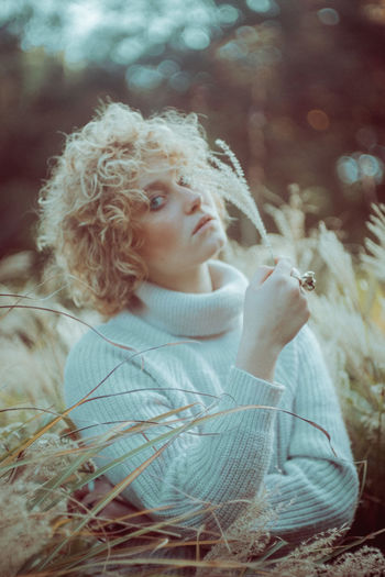Blond Hair Childhood Close-up Curly Hair Day Focus On Foreground Girls Leisure Activity Lifestyles Nature One Person Outdoors People Real People The Portraitist - 2017 EyeEm Awards Young Adult Young Women