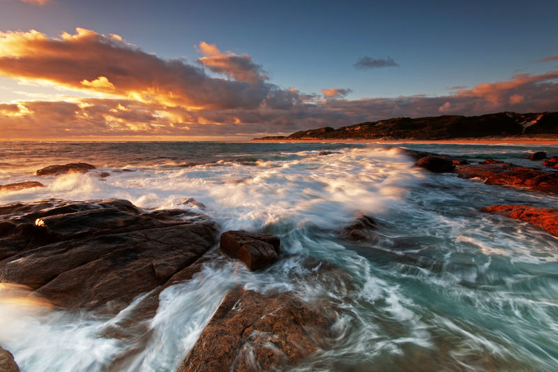 Margaret River Sunset Australia Margaret River Beach Dramatic Light Rock Travel Destinations Tourism Conceptual Backgrounds Long Exposure Wave Water Sea Sunset Beach Motion Sky Landscape Horizon Over Water Tide Surf Coastal Feature Power In Nature Crashing Seascape