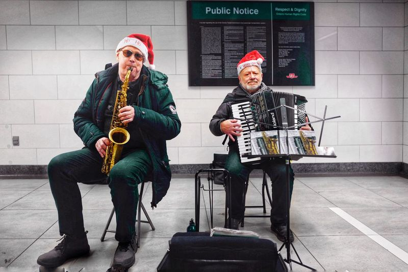 Christmas Eve Street Life Street Photography Moments Of Happiness 2018 In One Photograph Music Musical Instrument Arts Culture And Entertainment Artist Musician Playing Performance Architecture Saxophone Guitar Street Performer Adult People Musical Equipment Men City Two People Street Musician Holding Built Structure