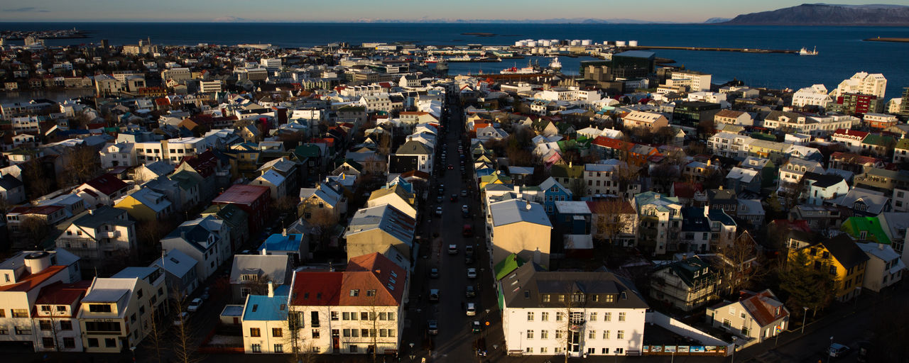 A view of downtown Reykjavik from the top of the Hallgrímskirkja November 19, 2012. Architecture Aurora Building Exterior Built Structure City Cityscape Community Crowded Day High Angle View Iceland Outdoors People Reykavik Reykavik S Sea Sky Sun Sunset Water Winter