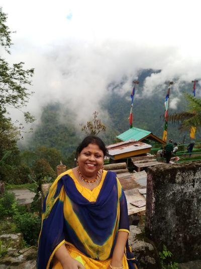 Portrait Of Smiling Woman Against Temple