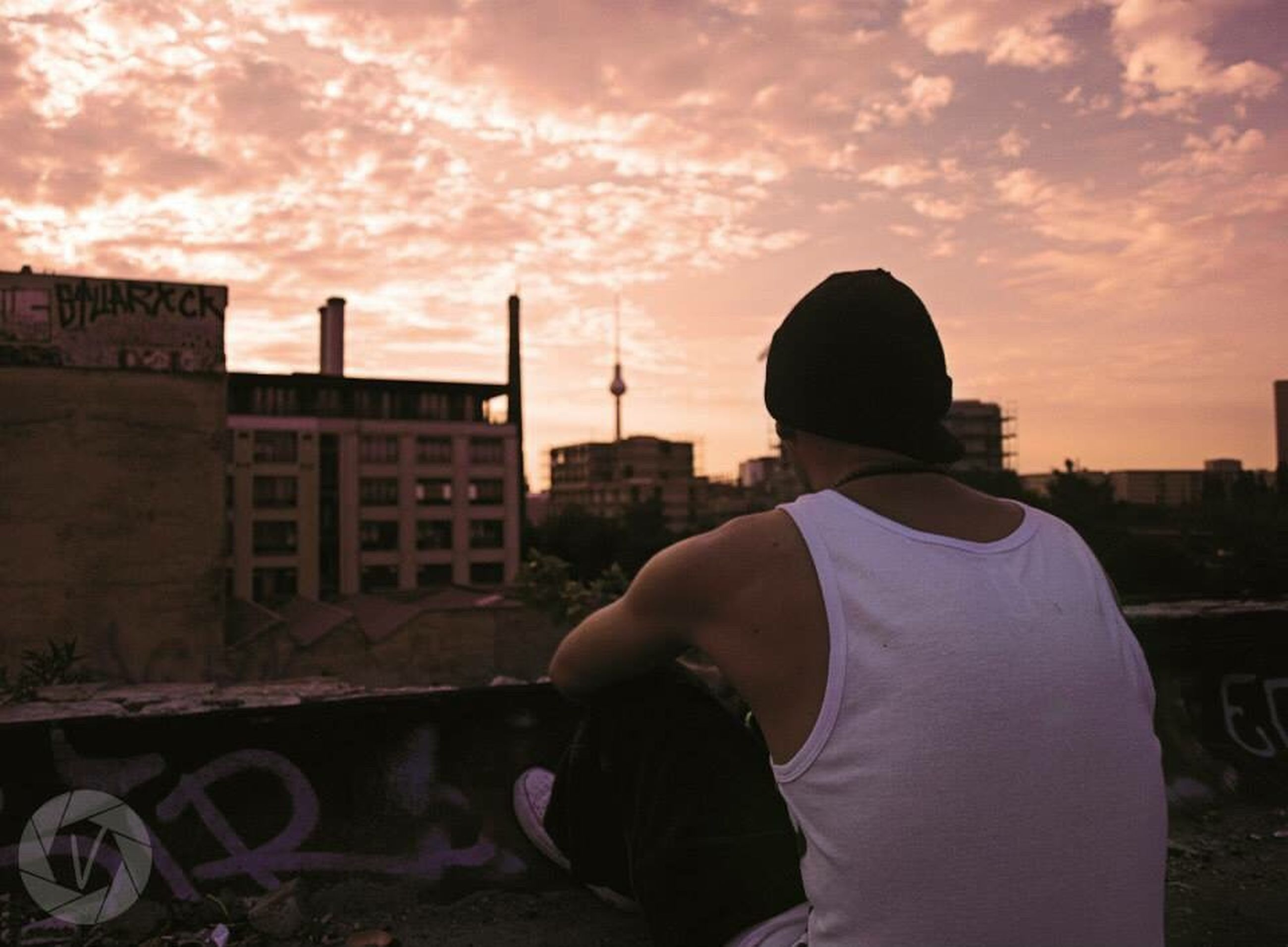 sky, sunset, cloud - sky, building exterior, lifestyles, rear view, built structure, architecture, leisure activity, cloud, waist up, cloudy, standing, three quarter length, men, city, person, casual clothing