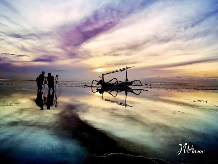 Sunset in Sanur beach. Sky Cloud - Sky Sunset Water Beauty In Nature Scenics Horizon Over Water Beach Outdoors Tranquility Tropical Climate Leisure Activity Reflection Lifestyles Sea Creative Artdesign By Me Silhouette Creative Edit Focus On Foreground