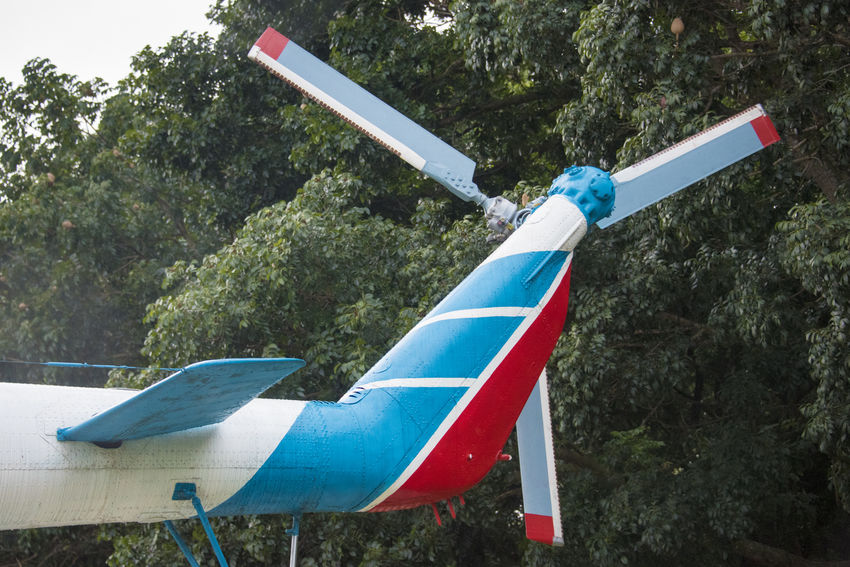 Cuban flag in tail of old Russian military helicopter. The apparatus decorate a public recreational plaza full of restaurants and other facilities in the Sandino Area Cuba Cuban Cuban Flag Day Detail Helicopter Low Angle View Military National Flag No People Outdoors Russian Taiwan