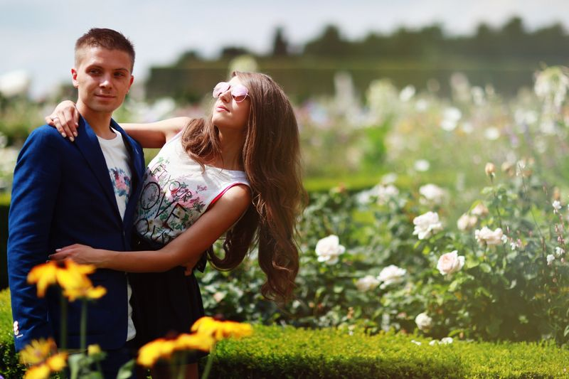 Portrait of young couple in rose garden