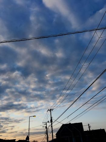 Cable Power Supply Cloud - Sky Power Line  Sky Connection Electricity  Low Angle View Technology Electricity Pylon Fuel And Power Generation Outdoors Telephone Line No People Building Exterior Built Structure Nature Day Architecture