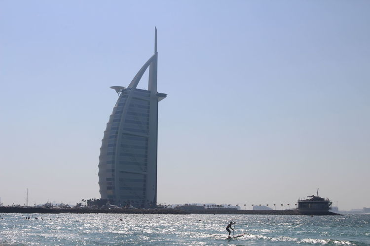 Architecture Beach Built Structure Burj El Arab Clear Sky Outdoors Paddle Sea Sky Travel Destinations Water