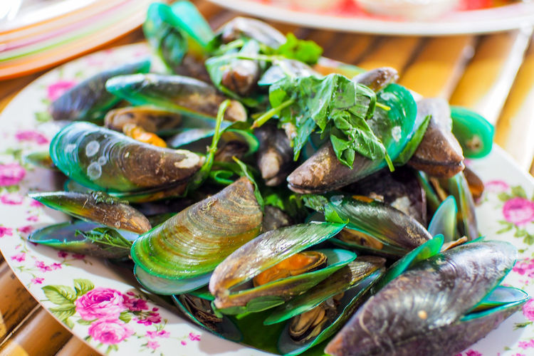 Close-up of mussel in plate on table