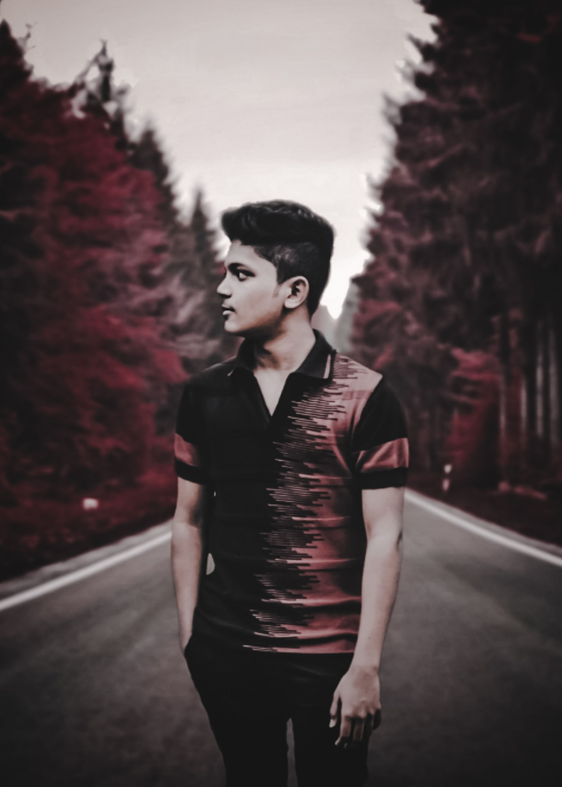 one person, standing, three quarter length, young adult, real people, focus on foreground, casual clothing, tree, front view, young men, lifestyles, leisure activity, plant, looking, clothing, looking away, contemplation, portrait, outdoors, hairstyle