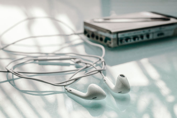 Yesteryears Hearing Aid Walkman Analog Music No People Indoors  Close-up White Color Connection Still Life Technology Representation Table Focus On Foreground Cable High Angle View Headphones Communication Toy Music Selective Focus Listening