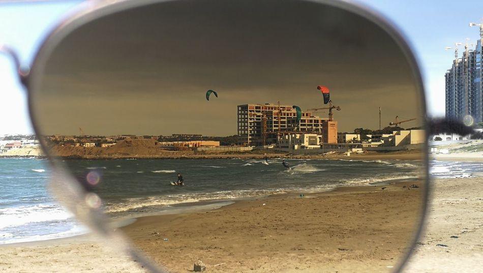 Summer is coming City Sea Beach Sand Water Skyscraper Sky Wave Surf Coastline Horizon Over Water Surfer Shore