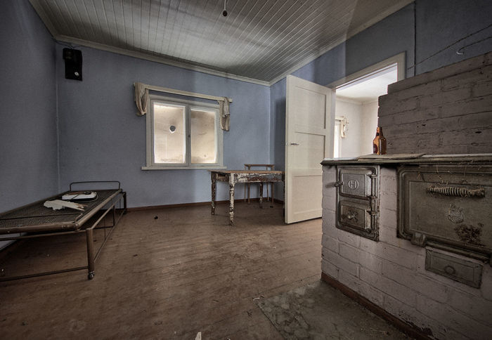 Deserted house interior with some interesting details. Chair Decay Decaying Building Deserted Deserted House Deserted Houses Dirty Empty Flooring Home House Indoors  Indoors  Interior Messy No People Obsolete Window