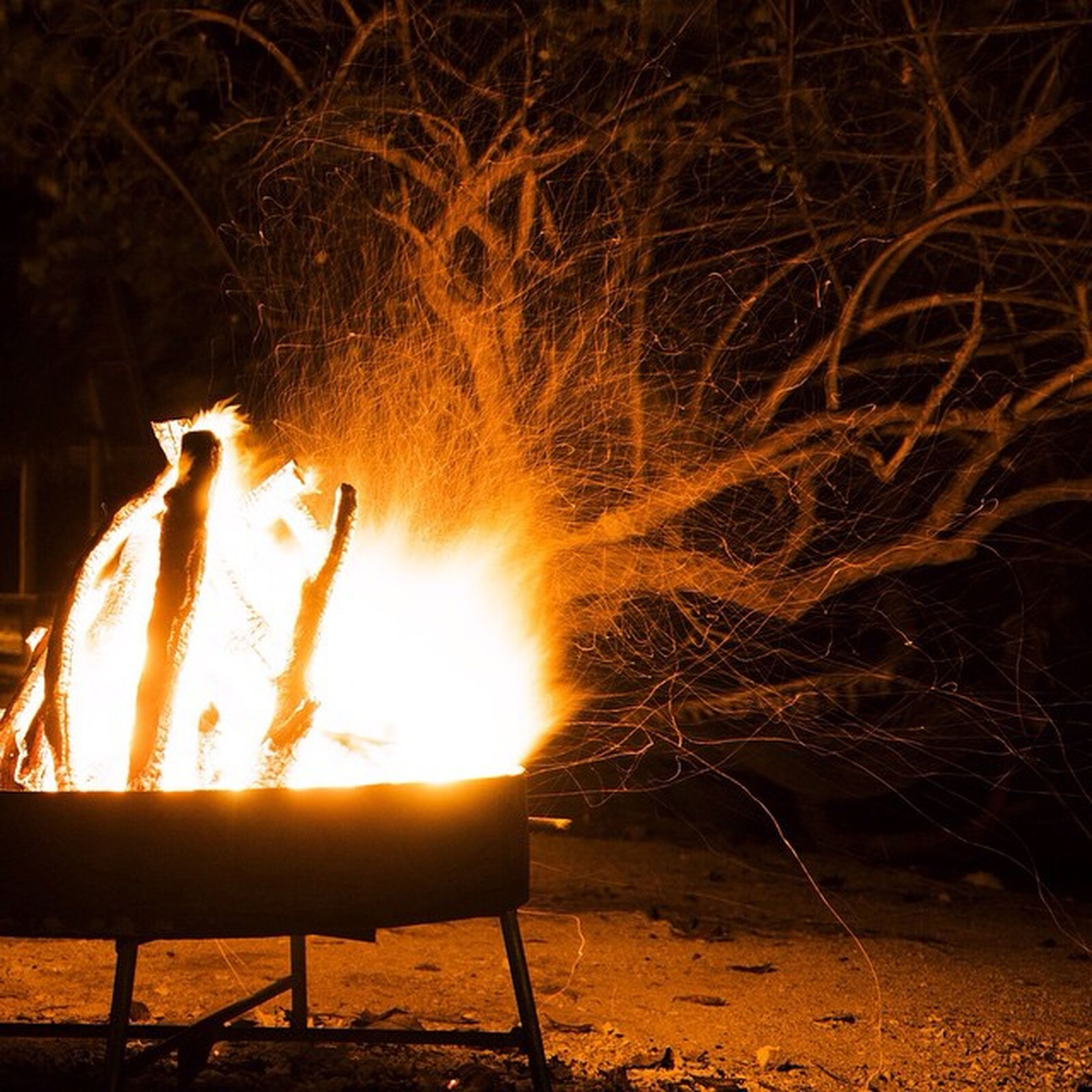 night, glowing, burning, illuminated, fire - natural phenomenon, flame, heat - temperature, sunlight, dark, sun, wood - material, light - natural phenomenon, nature, outdoors, no people, silhouette, bare tree, close-up, tranquility, sunset
