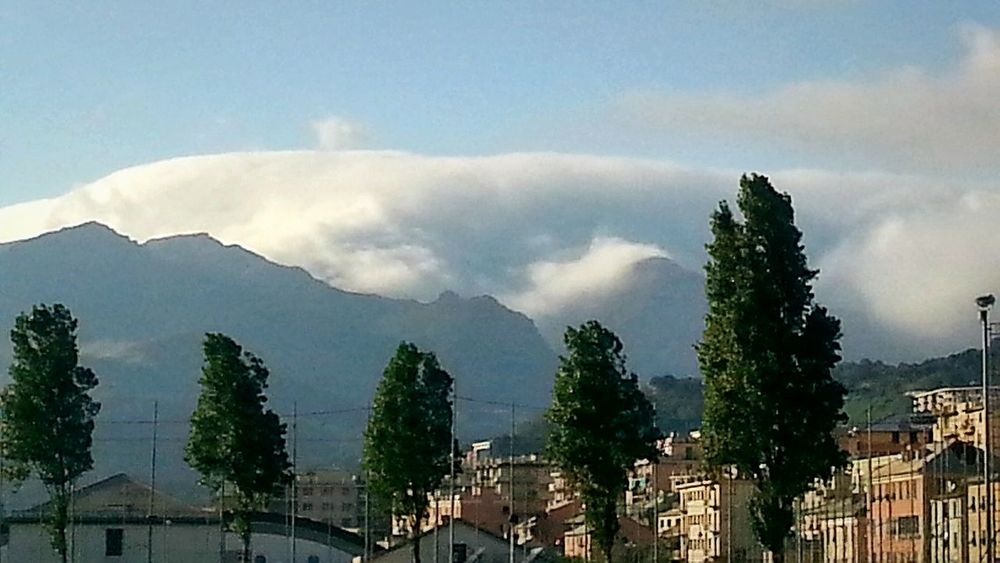 """""""Up there we call them fog..."""". Low clouds atop the mountains, they exactly follow the covered mountain skyline... Sky And Clouds Sky And Mountains Panoramic View Atmospheric Clouds Genova / WheaterPro: Your Perfect Wheater Shot"""