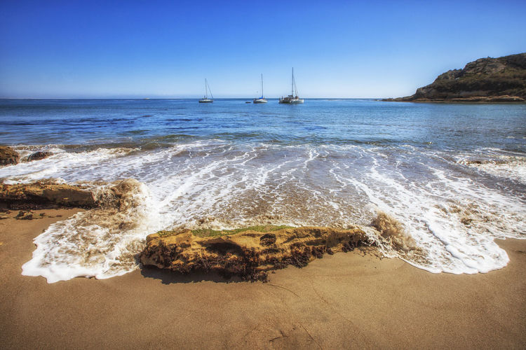 Pirate's Cove Beach Beach Beauty In Nature Blue Calm Clear Sky Horizon Over Water Mode Of Transport Nature Nautical Vessel Pirates Cove Sand Scenics Sea Seascape Shore Surf Tide Tourism Tranquil Scene Tranquility Transportation Travel Destinations Vacations Water Wave