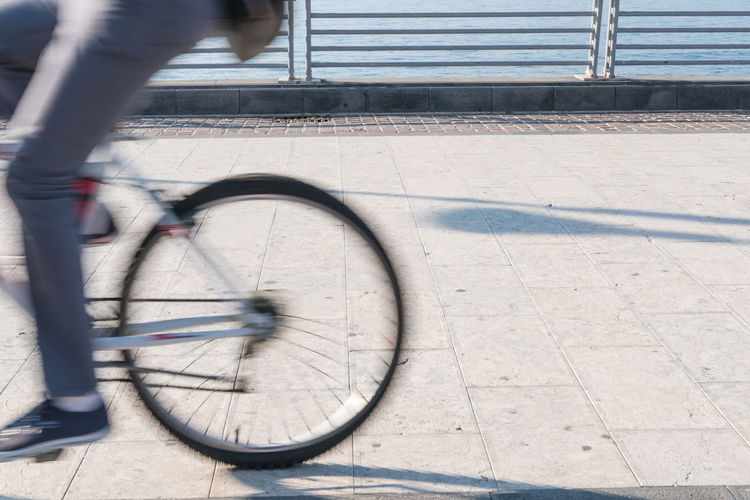 Blurred motion of person on bicycle street