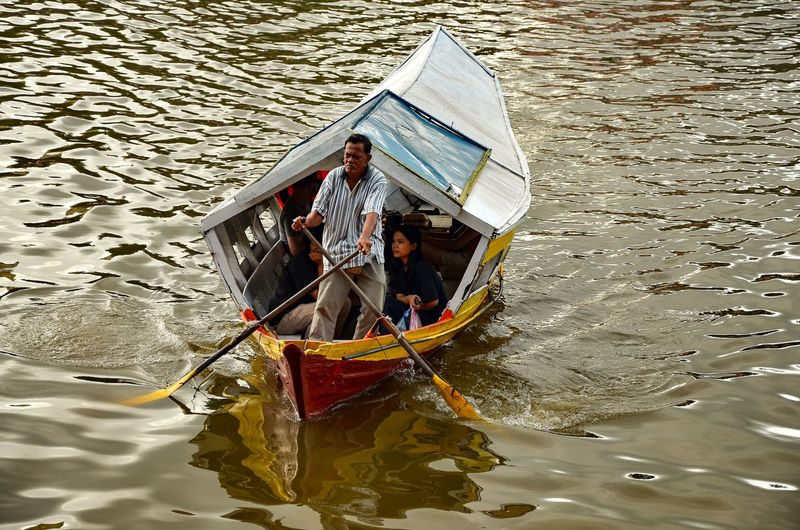 High angle view of men on boat in river