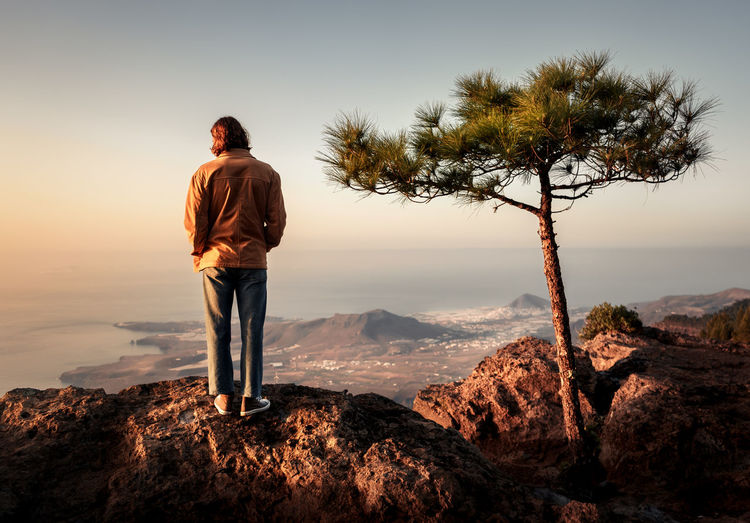 Boy Tree Rock Sky Cliff Quiet Moments GranCanaria One Person Lifestyles Real People Standing Leisure Activity Beauty In Nature Scenics - Nature Rear View Rock - Object Full Length Nature Non-urban Scene Mountain Tranquility Plant Sunset Solid Outdoors Looking At View Springtime Decadence