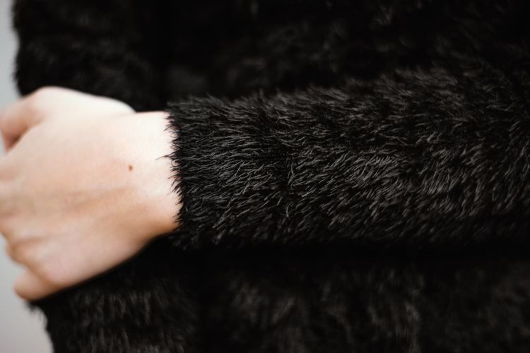 Human Hand Hand Human Body Part One Person Real People Holding Body Part Close-up Unrecognizable Person Human Finger Finger Lifestyles Fur Black Color