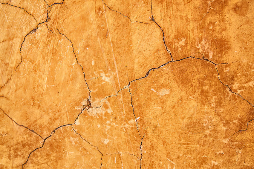 Crack clay wall texture and background,material construction. Exterior Wall Abstract Arid Climate Backgrounds Bad Condition Brown Cement Clay Close-up Cracked Damaged Day Dividing Full Frame Grunge Multi Colored Nature No People Outdoors Pattern Textured  Textured Effect Weathered