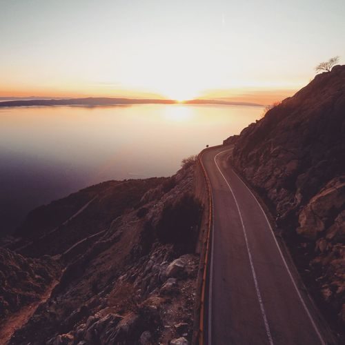 Scenic mountain road over calm blue Adriatic sea Adriatic Aerial Beauty In Nature Calm Idyllic Mediterranean  Mountain Nature Nobody Non-urban Scene Relax Road Scenic Scenics Sea Sky Summer Sun Sunlight Sunset The Way Forward Tranquil Scene Tranquility Transportation Travel