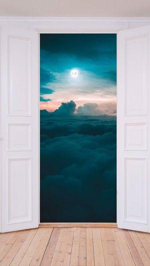 Scenic view of blue sky seen through open door