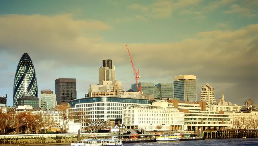 London skyline against cloudy sky