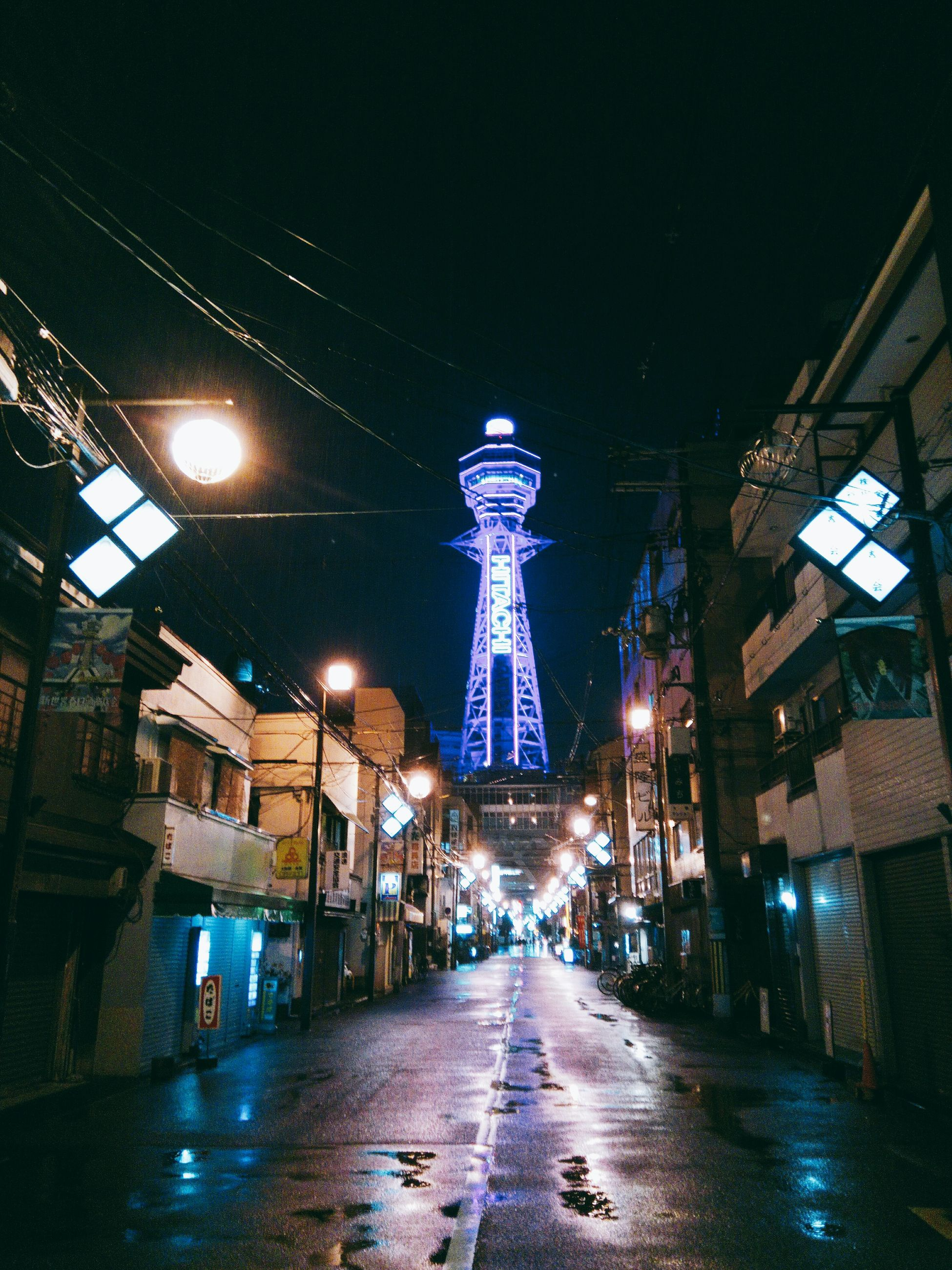 illuminated, night, architecture, built structure, direction, lighting equipment, building exterior, the way forward, street, city, transportation, tower, building, no people, street light, electricity, sky, outdoors, nature, communication, light