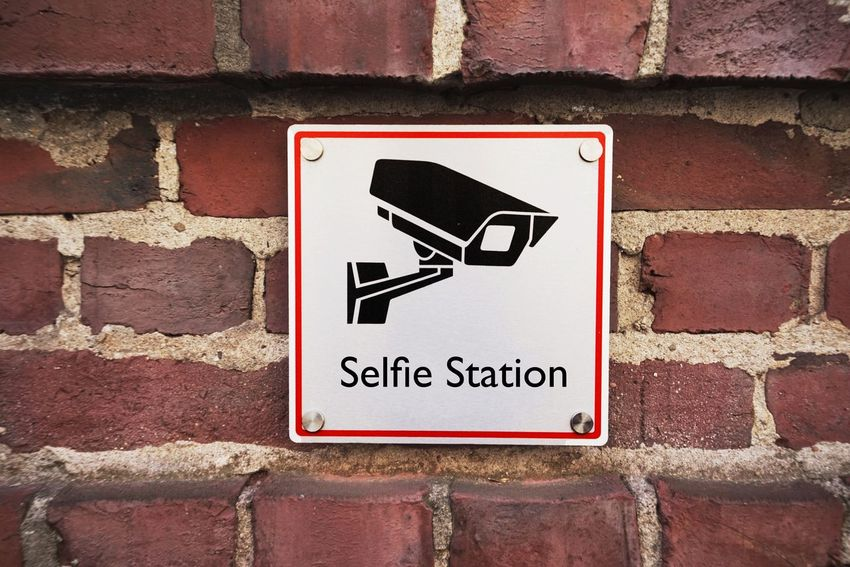 Video Camera Communication Text Sign Brick Brick Wall Wall Western Script No People Wall - Building Feature Warning Sign Forbidden Day Close-up Information Safety