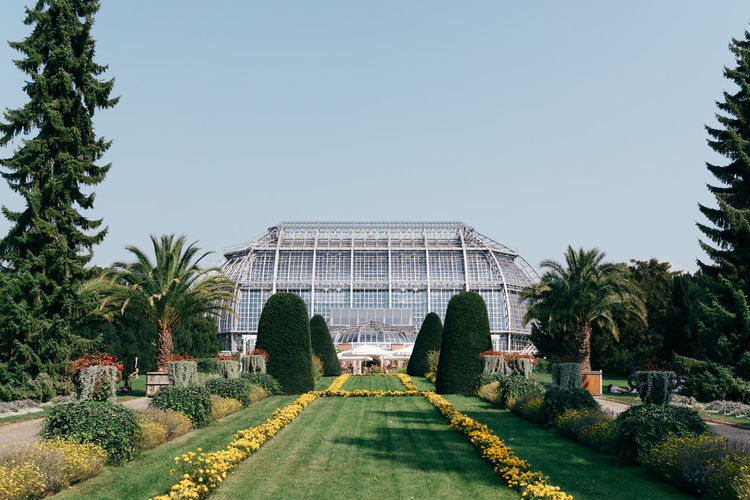 Architecture Blue Blue Sky Botanical Gardens Day Flowers Garden Greenhouse Growth Nature No People Outdoors Plants Tree