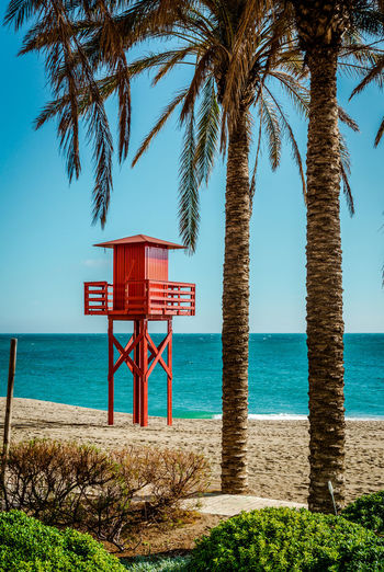 Lifeguard tower on the beach. Benalmadena, Malaga. Spain Andalucía Benalmádena, Malaga, Spain Bright Colors Holiday Malaga Mediterranean Sea SPAIN Seashore Beach Beach Guard Coast Costa Del Sol Horizon Over Water Lifeguard  Lifeguard Tower Lookout Tower Observation Tower Palm Trees Safety Sandy Beach Sea Tower Vacation Waterfront Wooden
