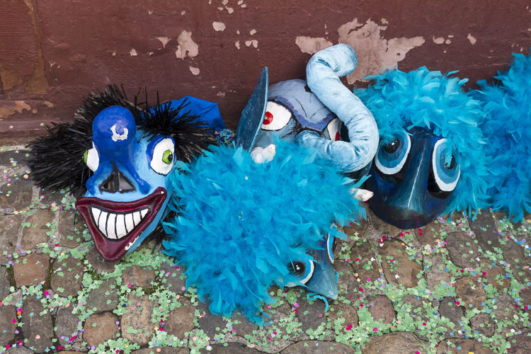 Nadelberg, Basel, Switzerland - March 7, 2017. Funny blue carnival masks laying on the confetti covered street. Basel Carnival Celebration Creativity Event Fun Funny Objects Tourist Attraction  Tradition Blue Celebration Close-up Colorful Confetti Fasnacht Festival Front View Mask - Disguise No People Shrove Tuesday Street Streetphotography Swiss Switzerland