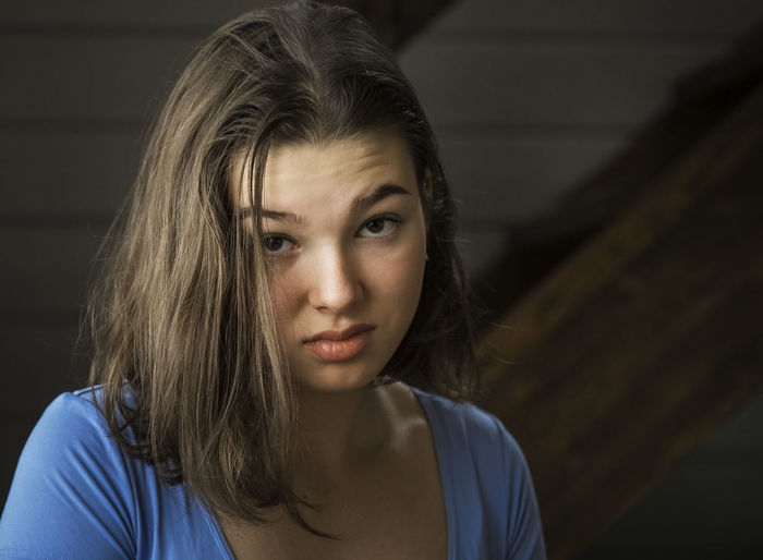 Portrait of girl making irritating face with raised eyebrow