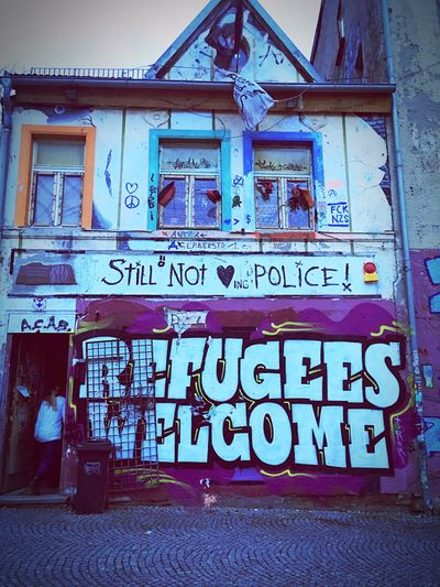 Refugees welcome Text Communication Built Structure Architecture Day Building Exterior Outdoors Refugees Refugee Welcome Outside Outdoor Photography Outdoors Outdoors Photograpghy  Street Streets Street Photography Streetphotography Street Art Street Arts  Street Art/Graffiti Urban Art Urban Urbanphotography Urban Lifestyle The Street Photographer The Street Photographer - 2017 EyeEm Awards