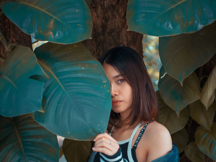 leaf live vibe Young Adult Portrait Lifestyles Real People Leisure Activity Young Women One Person Looking At Camera Headshot Adult Casual Clothing Front View Women Nature Beautiful Woman Day Tree Plant Outdoors Hairstyle Turquoise Colored Leaf