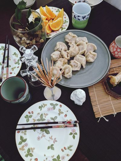 Dumplings Are Chinese Food Chinese Food Plate Tablecloth Table Bowl High Angle View Directly Above Food And Drink Dumpling  Chinese Dumpling Chinese Food Stir-fried Place Setting Setting The Table Prepared Food Chopsticks Chinese Culture Dim Sum Chinese Takeout