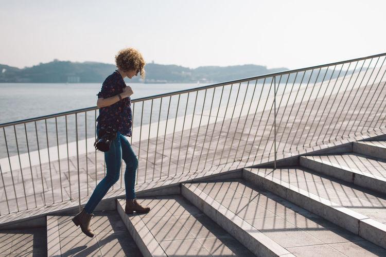 Woman walking on steps in city