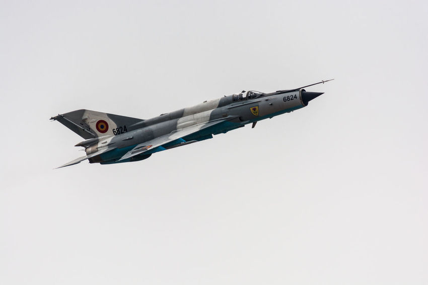 MiG-21 Lancer Jet Fighter of the Romanian Air Forces during Aeromania Air Show. It's an iconic machine and a staple of the Romanian Air Forces. 2016 Aeromania Aircraft Airplane Airport Airshow Airshow Demonstration Airshowphotography Blue Day Flying Iconic Jet Fighter Low Angle View MIG-21 Lancer Military Military Airplane Nature No People Outdoors Pilot Romania Romanian Air Forces Skill  Sky