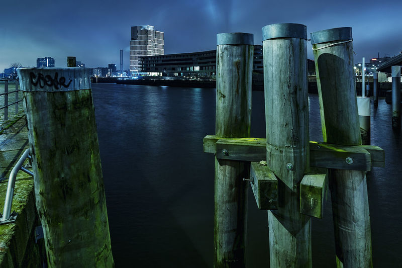 Harbor view at night Dalben Long Exposure Night Sky Nightphoto Built Structure Architecture Building Exterior No People Sky Water Nature City Wood - Material River Illuminated Dusk Outdoors Day Metal Blue Post Landscape Office Building Exterior Skyscraper Wooden Post